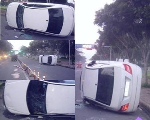 Xe của chồng nữ ca sĩ Phạm Quỳnh Anh bị lật 2 vòng và xô ngã biển báo giao thông và gây hư hại vạch ngăn cách. Rất may là những người trong xe đều không bị chấn thương nào quá nặng - Tin sao Viet - Tin tuc sao Viet - Scandal sao Viet - Tin tuc cua Sao - Tin cua Sao