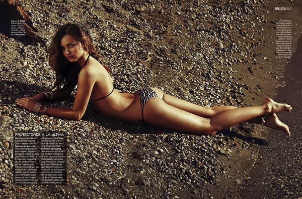 Miranda Kerr ngực trần bỏng mắt dạo biển trên tạp chí Elle
