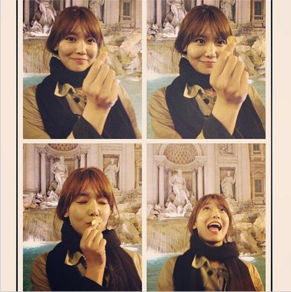 """Sooyoung khoe hình cầm đồng tiền khi đi du lịch ở Rome với nội dung: """"Cầu nguyện nào"""""""