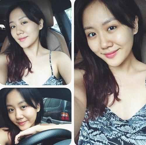 Văn Mai Hương khoe mặt mộc xinh đẹp, tự lái xe đi mua cafe uống vào một chiều mưa.