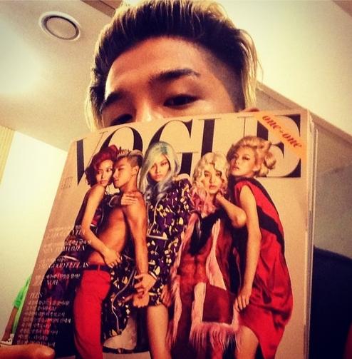 Taeyang khoe hình cầm tạp chí có hình anh làm ảnh bìa