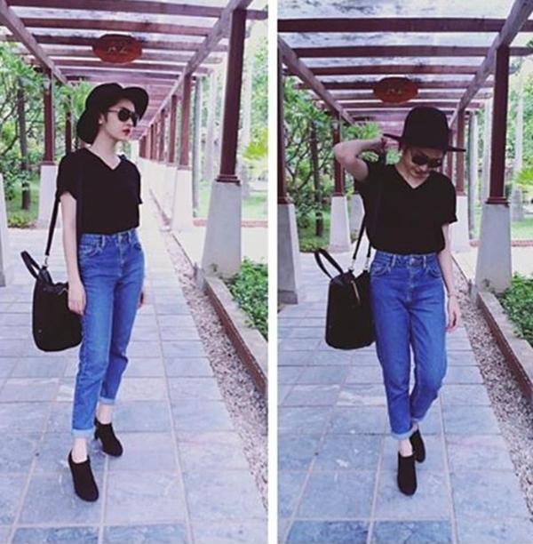 """Bảo Anh """"chuẩn men"""" khi diện chiếc quần bò kết hợp với áo phông đen đơn giản, bên cạnh đó là cặp mắt kiếng và túi xách cùng màu khiến cho cô nàng thêm nổi bật và thu hút ánh nhìn của mọi người xung quanh."""