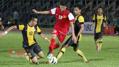 Lối đá phòng ngự chắc chắn của U21 Malaysia đã khóa được các mũi tấn công của U19 Việt Nam. Ảnh: Đức Nguyễn