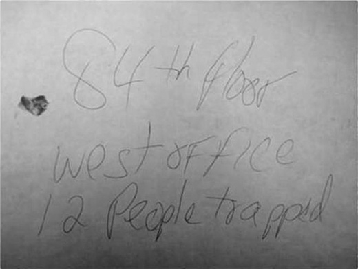 Mẩu giấy dính máu của một nạn nhân đã chết trong Tháp Đôi WTC hôm 11/9/2001. Ảnh: New York Daily News