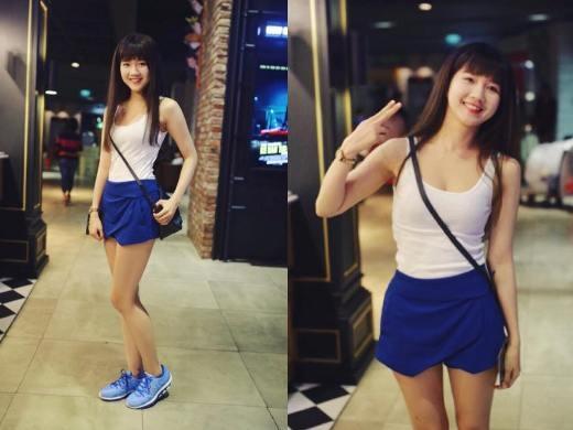 Bạn gái Chi Pu- Kiều Trinh trông cực thể thao với áo tank top, váy origami và giày thể thao cùng tông