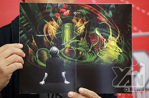 Thành Lộc đã mang đến cho YAN Chat một bức tranh tặng kèm theo quyển sách . - Tin sao Viet - Tin tuc sao Viet - Scandal sao Viet - Tin tuc cua Sao - Tin cua Sao