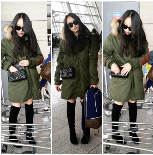 Victoria khoe hình đang loay hoay tại sân bay với phong cách lạnh lùng