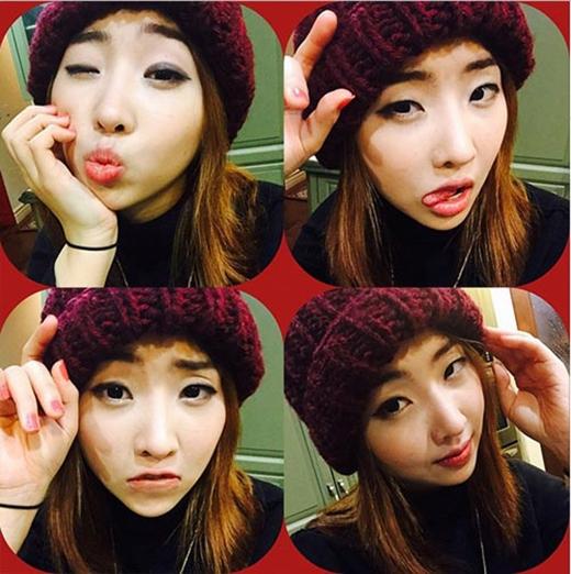 Minzy thích thú khoe hình với chiếc nón beanie mới, cô chia sẻ: Bạn tôi làm nón này cho tôi nè. Cám ơn nhé chị gái.