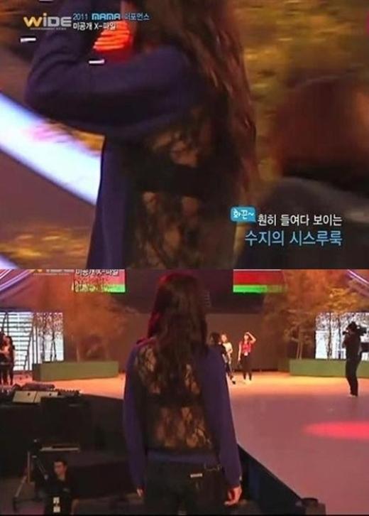 """""""Tình đầu quốc dân"""" Suzy nhận khá nhiều chỉ trích cho sự cố chọn trang phục năm 2011. Phần sau của chiếc áo phản cảm làm """"ngứa mắt"""" cư dân mạng, đồng thời, với nữ thần tượng 17 tuổi thì trang phục này hoàn toàn không phù hợp."""