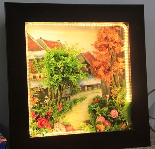 Bức tranh hoa phố cổ được khách đặt dịp 8/3 có giá 2 triệu đồng. Ảnh: Ngọc Lan.