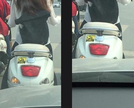 Cô gái dán logo độc trên xe máy gây xôn xao.