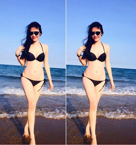 Dù mang thai nhưng Thủy Anh vẫn tự tin phô diễn dáng tuyệt đẹp và làn da trắng ngần với bikini màu đen.