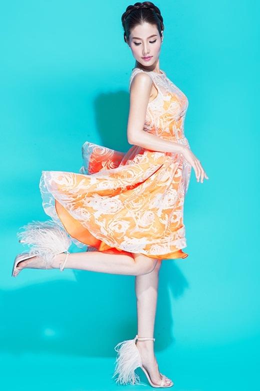 Diễm My tung bay trong bộ váy màu cam nổi bật