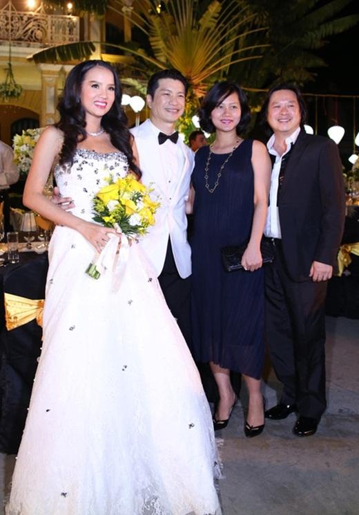 Vợ chồng Đỗ Hải Yến trong đám cưới Dustin Nguyễn - Bebe Phạm. - Tin sao Viet - Tin tuc sao Viet - Scandal sao Viet - Tin tuc cua Sao - Tin cua Sao