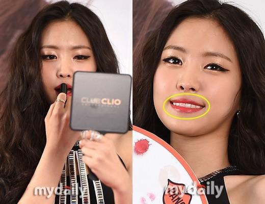 """Trong khi đó, Naeun (A Pink) lại """"dặm"""" son quá đà khiến răng cũng bị dính son trông mất thẩm mỹ vô cùng."""