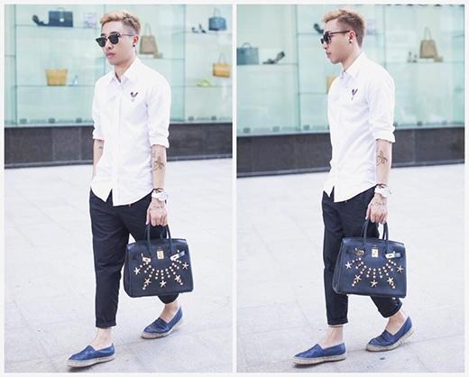 Stylist Hoàng Ku tiếp tục lăng xê hai gam màu trắng, đen cổ điển bằng trang phục của những thương hiệu nổi tiếng. Anh chàng cũng không ngần ngại mang theo túi xách đậm chất nữ tính nhằm tăng thêm sự lạ mắt cho bộ trang phục khá an toàn.