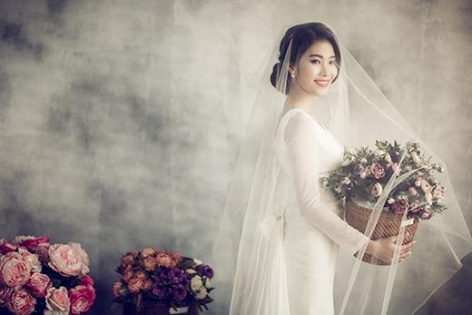 Hình ảnh của một cô dâu cổ điển, thanh lịch nhưng không kém phần trẻ trung, điệu đà.