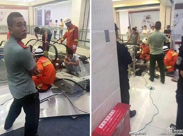 Lực lượng chức năng cắt thang cuốn để đưa thi thể nạn nhân ra ngoài