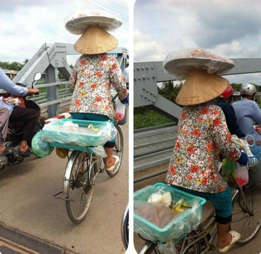 Vừa đạp xe đạp, vừa đội nón, còn đội thêm một mẹt bánh trên đầu, thế mà vẫn đi được. Không phải ai cũng có thể làm được những điều kì diệu thế này, cô quá giỏi luôn phải không mọi người?