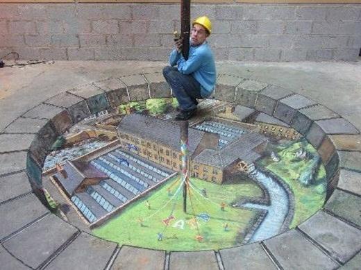 Một anh chàng tạo dáng ngộ nghĩnh với bức tranh 3D.