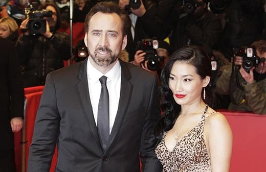 Nicolas Cage gặp vợ Alice Kim khi cô đang làm phục vụ tại nhà hàng Kabuki ở Los Angeles. Kim rất yêu thích phim của Nicolas và đã tới xin chữ kí kèm ảnhchàng diễn viên. Sau đó hai người trao đổi số điện thoại,cuối cùng họ nên duyên vàmột đám cưới đã diễn ra năm 2004 tại Bắc California.