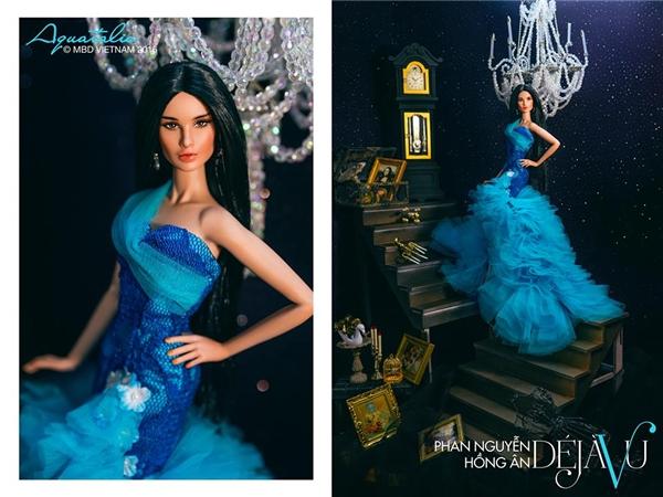 Cô búp bê xinh đẹp Phan Nguyễn Hồng Ân được diện bộ váy kết hợp xen kẽ giữa hai tông màu xanh đậm, xanh nhạt. Thiết kế tạo điểm nhấn với phần đuôi cá bồng xòe được tạo nên từ những chi tiết voan lụa.