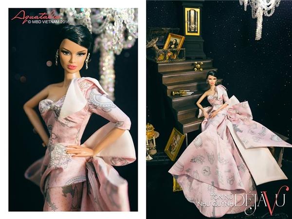 Tông hồng pastel mang đến vẻ ngoài ngọt ngào cho thí sinh Tôn Nữ Như Quỳnh. Mẫu thiết kế dựa trên phom váy đuôi cá truyền thống nhưng được cách điệu lạ mắt.