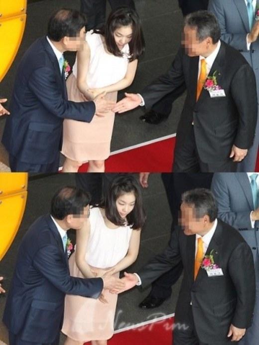 """""""Nữ hoàng sân băng"""" Kim Yuna """"vạn người mê"""" cũng từng có giây phút bị """"hắt hủi"""" bởi hai viên quan chức bận bắt tay nhau mà quên mất đôi tay cũng đang chìa ra của cô nàng."""