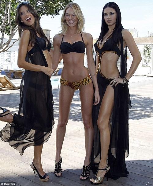 Trước đây, thiên thần Victoria's Secret - Candice Swanepoel (giữa) cũng nhiều lần bị chỉ trích vì thân hình gầy đến trơ xương của cô