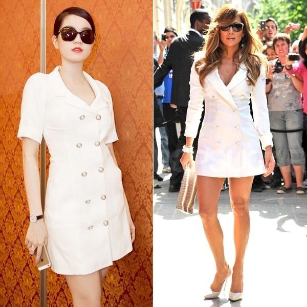 Với chiếc shirt dress màu trắng mà Rachel Zoe từng diện, Ngọc Trinh lại biến tấu phần tay trở nên ngắn gọn hơn. Bộ váy được nhận xét giúp chân dài trở nên trẻ trung, thanh lịch nhưng không kém phần sang trọng.