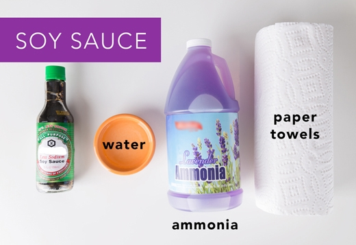 Tương đậu nành: Hứng chỗ dính nước tương dưới vòi nước chảy. Sau đó dùng khăn giấy nhúng dung dịch amoniac pha nước để thấm sạch (tỉlệ 1 amoniac + 2 nước). (Ảnh: Greatist)