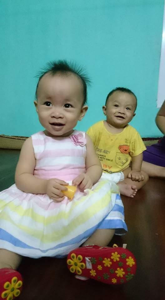 Hình ảnh 2 em nhỏ được cài làm hình nền điện thoại của chồng chị Mai Hảo Ngọc.