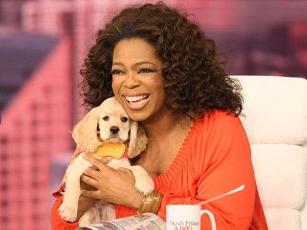 Oprah Winfrey cùng chú chó cưng. (Ảnh: Internet)