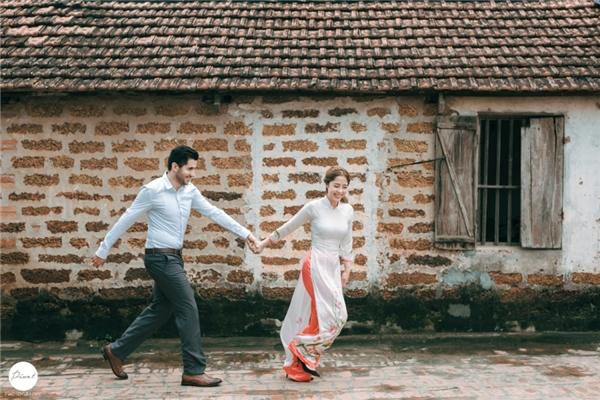 Cặp đôi dễ thương này cũng lựa chọn áo dài, váy cưới và đồ Tây để chụp hình cưới cho bộ ảnh kỉ niệm lần này.(Ảnh: Internet)