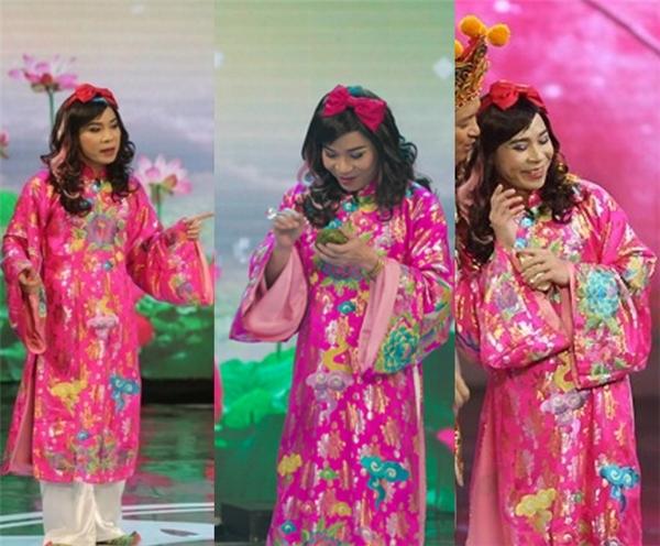 Sang năm 2015, cô Đẩu tiếp tục hình ảnh nữ tính với trang phục áo dài màu hồng thêu hình long ly quy phượng. - Tin sao Viet - Tin tuc sao Viet - Scandal sao Viet - Tin tuc cua Sao - Tin cua Sao