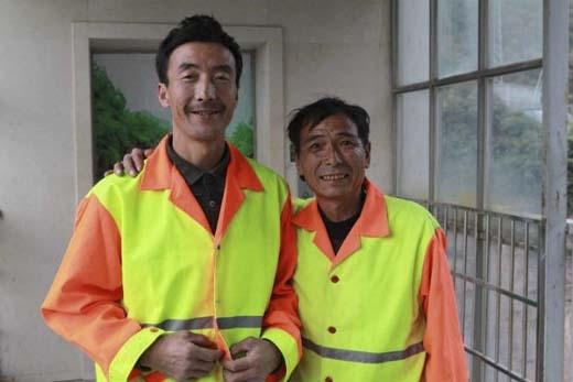 Hai Người Nhện trên chính công nhân vệ sinh Liu Jiancheng và Zhang Chengqing. (Ảnh: Internet)