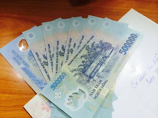 Nhiều người được nhận tiền lì xì khủng, đa số lànhững tờ 500 ngàn. (Ảnh: Internet)