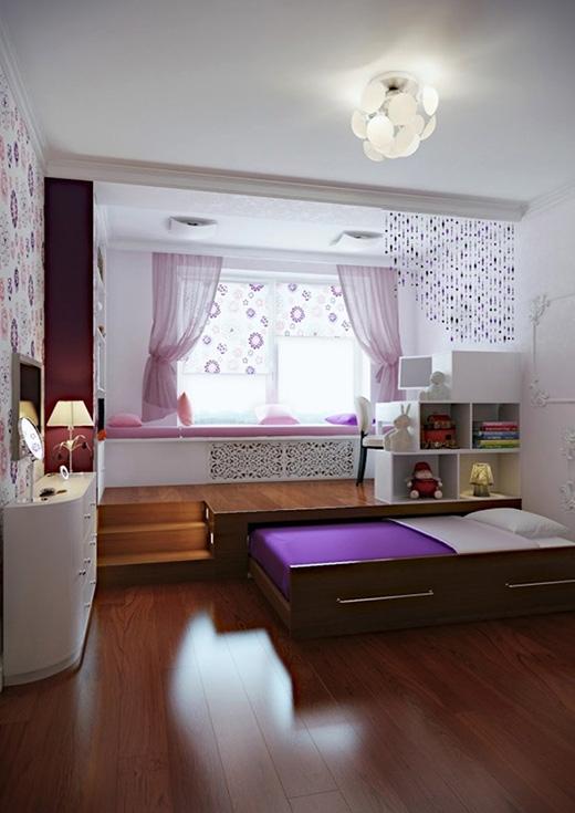 Phòng khách kết hợp phòng làm việc được nâng lên để lấy chỗ cho chiếc giường giấu bên dưới. (Ảnh: Internet)