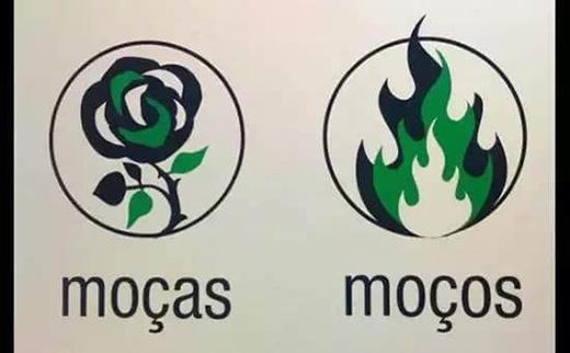Tấm biển toilet này ví von người phụ nữ như đóa hoa mềm mại còn người đàn ông như ngọn lửa bùng cháy rất thi vị. (Ảnh: Internet)