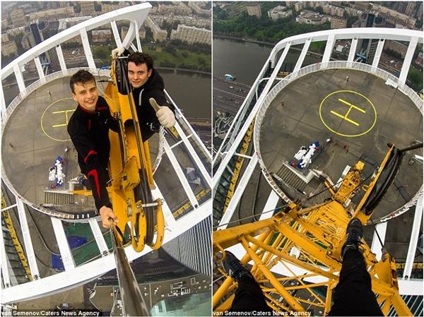 Semenov nhìn ra cảnh quan tuyệt đẹp của Dubai sau khi chạm tới đỉnh cao nhất của tòa nhà này.(Ảnh: Daily Mail)Semenov cùng một anh bạn dũng cảm đang lơ lửng giữa một sân bay trực thăng.(Ảnh: Daily Mail)