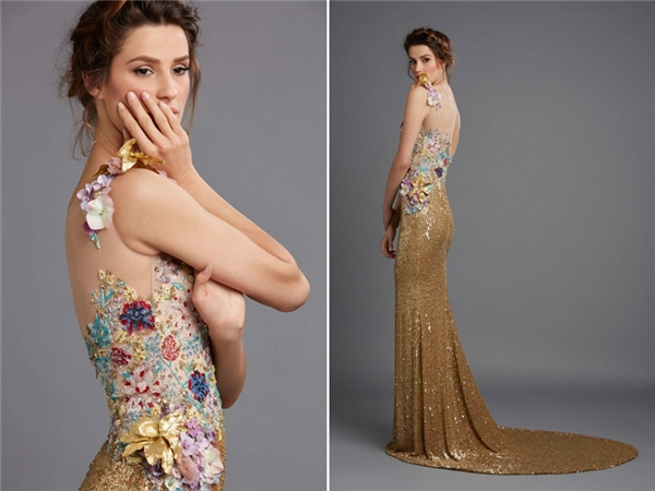 Khác với các hãng thiết kế khác,Hamda Al Fahim lựa chọn tông màu vàng ánh kim cho thiết kế của mình. Một rừng hoa bốn mùa được điểm xuyến quanh thân áo là điểm sáng nổi bật củachiếc váycưới này.(Ảnh:Internet)