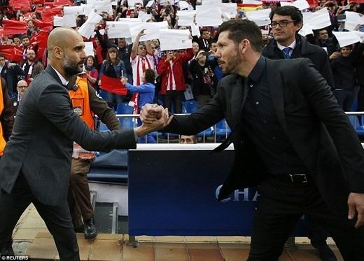 Simeone (phải) đã đánh bại Guardiola (trái) lừng danh trong cuộc đấu trí.Ảnh: Reuters