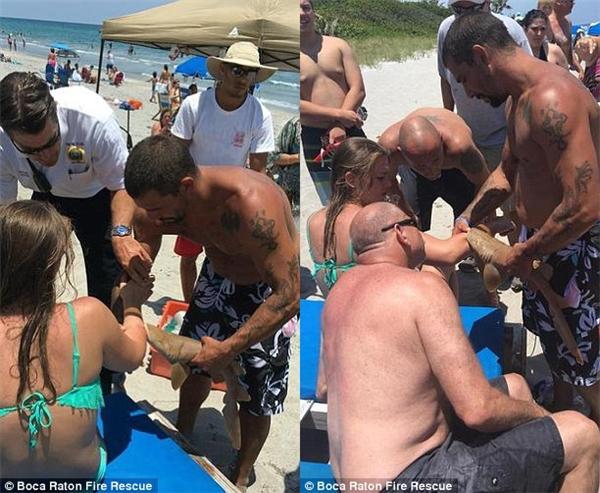 Kết quả là họ phải nẹp cả con cá mập vào tay cô gái để đưa cô đến bệnh viện. (Ảnh: Internet)