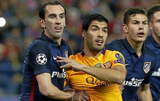 Diego Godin (trái) và Luis Suarez (phải) đều có tên trong đội hình tiêu biểu La Liga.