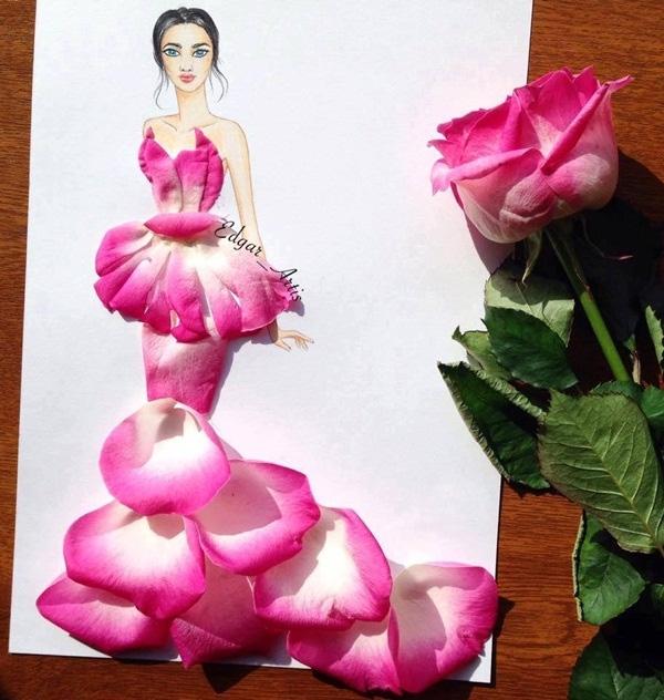 Dáng váy đuôi cá đượcthực hiện bằng những cánh hoa hồng mỏng manh, tông màu ngọt ngào.