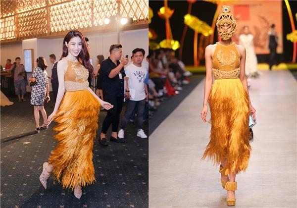 Dù không sở hữu chiều cao nổi trội như người mẫu nhưng Diễm My vẫn tỏa sáng khi diện thiết kế tua rua màu vàng cam nằm trong bộ sưu lúa của nhà thiết kế Công Trí.