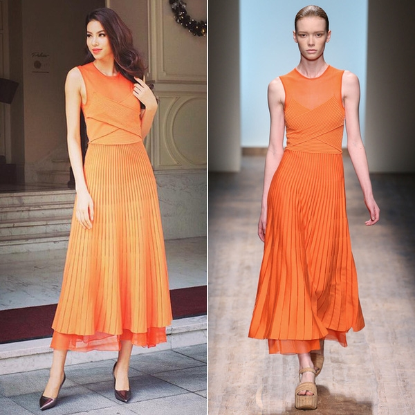 Mái tóc uốn xoăn bồng bềnh giúp Phạm Hương trông quyến rũ hơn trong thiết kế màu cam nóng bỏng, ngọt ngào.