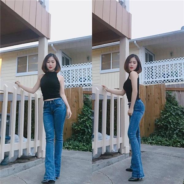 Hương Tràm khoe street style năng động, sexy với áo crop-top và quần bò ống loe. - Tin sao Viet - Tin tuc sao Viet - Scandal sao Viet - Tin tuc cua Sao - Tin cua Sao