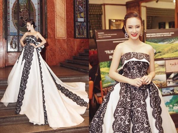 Tham dự đêm tiệc điện ảnh, nữ diễn viên diện bộ váy bồng xòe với sắc trắng làm chủ đạo. Thiết kế tạo điểm nhấn bởi chi tiết ren đen tương phản đính kết theo tỉ lệ. Đây là bộ váy nhà thiết kế Đỗ Mạnh Cường thực hiện riêng cho nữ diễn viên 9X.