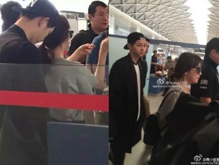 Song Joong Ki liên tục đưa tay bảo vệ Song Hye Kyo tại sân bay